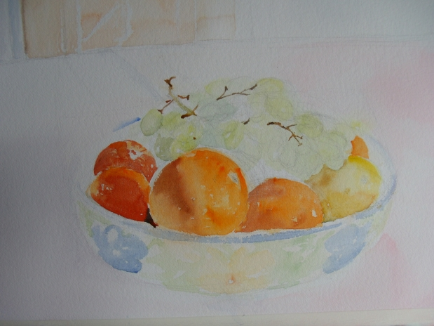 A fruit bowl on a white tablecloth