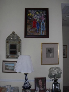 A living room with some paintings on the wall.
