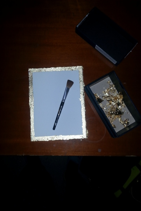 When you brush off the gold leaf, keep the excess in a box.