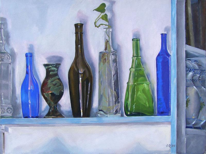 Colorfull Glass Bottles on Shelf