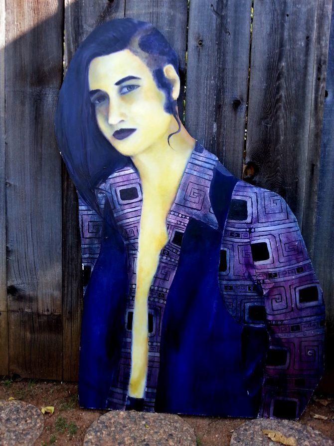 An oil painting on wood of a guy named Neil. Long black hair, grey eyes and a vest over a purple shirt with a design in sliver leaf.