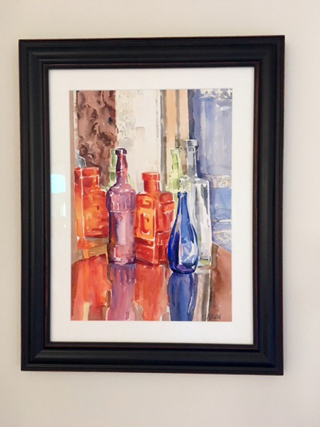 Glass Bottles on Table 2014 (framed)