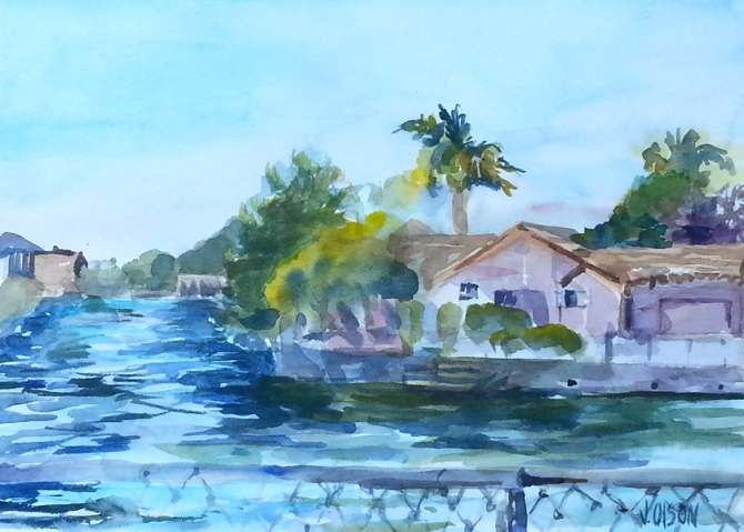 A watercolor of one of the many Lagoons in Alameda. Houses on each side of a saltwater river with a fence in the foregroound.