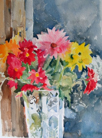 A watercolor of colorful flowers, pink, red, yellow, orange and white in a crystal vase.