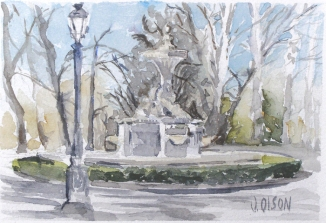 small watercolor of Fuente de los Galapagos. Can see a stone fountain in the winter with bare trees in the background. There is a light post in the foreground.