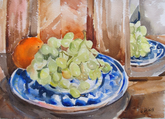 Watercolor of a white plate with blue design with grapes and a tangerine reflected in the mirror.