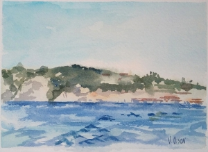 Watercolor of La Jolla Cove in San Diego California. A blue sky over the Pacific ocean with land in the horizon.