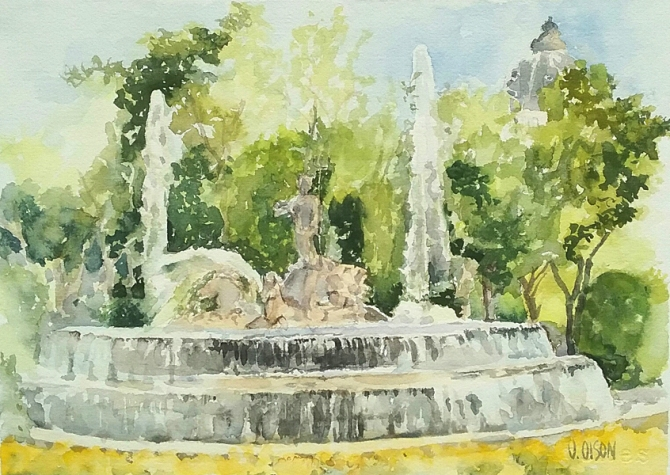 Watercolor of Neptune Fountain in Madid close to the Prado Museum. A fountain with water shooting up in the air between trees a a faint view of buildings in the distance. Nepturn Fountain is a stone fountain with Neputne standing in the middle riding on top of Horses drawing him as he rides the waves.