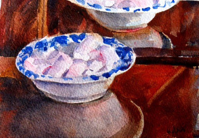 A small watercolor of marshmellows in a blue ceramic dish reflected in the mirror.