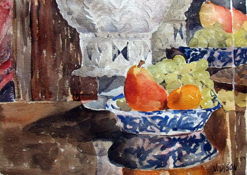 A watercolor of a spanish botijo and grapes, pear and small peach in a blue bowl on a table reflected in the mirror.