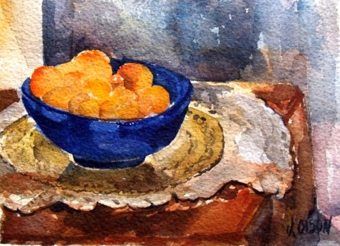 A small watercolor of tangerines in glass blue bowl sitting on a table