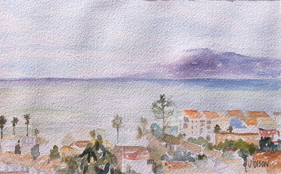 A watercolor of the Medeterranean sea with a cloudy sky and calm blue water the village below
