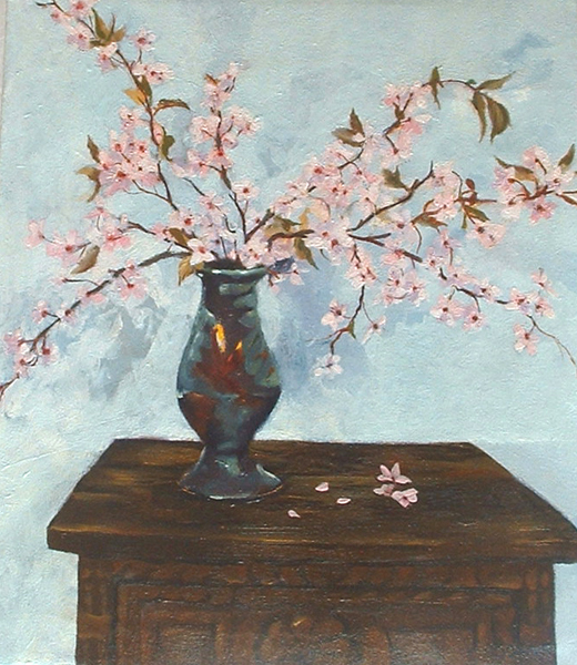 An oil painting of a simple rustic night table with a rachu pinch pot full of Almond blossoms against a white wall. The flowers shadows are cast on the wall and there are little pink petals on the wooden night stand.