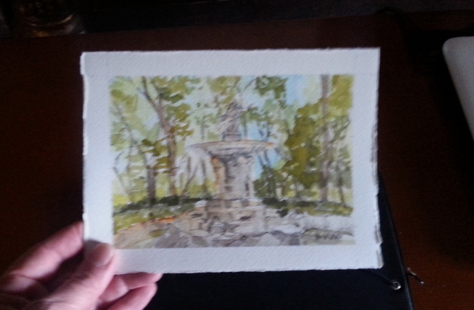 The watercolor of Fuente de Narciso held in my hand to see the size.