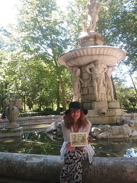A photograph of me sitting on the edge of the Narciso fountain with a watercolor of the fountain in my hand.