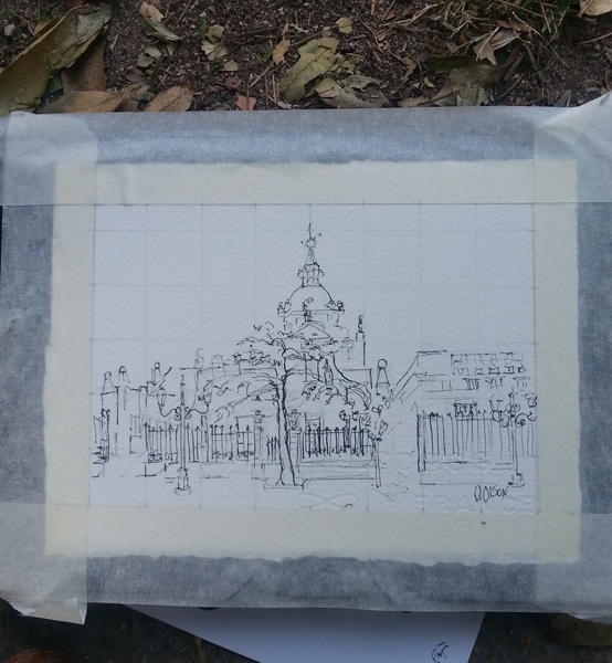 A photo of a pen and ink drawing of the Almudena Cathedral taped down to the drawing board.