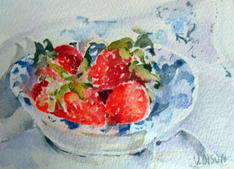 Small watercolor of strawberries in ceramic dish with blue leaf design on top of talavera tablecoloth