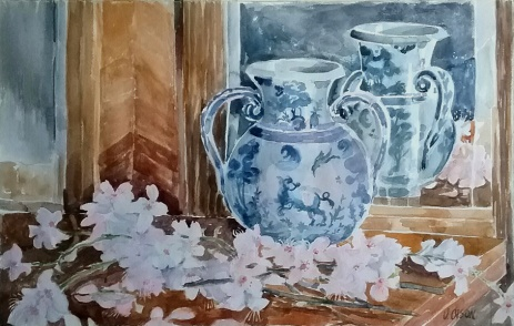 A watercolor of a Talavera Vase reflecting in the mirror with Almondo Flowers spread out in forefround.