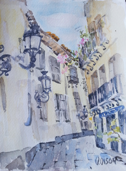 watercolor of a small street in Madrid with old fashioned light posts and narrow street with stone floor.