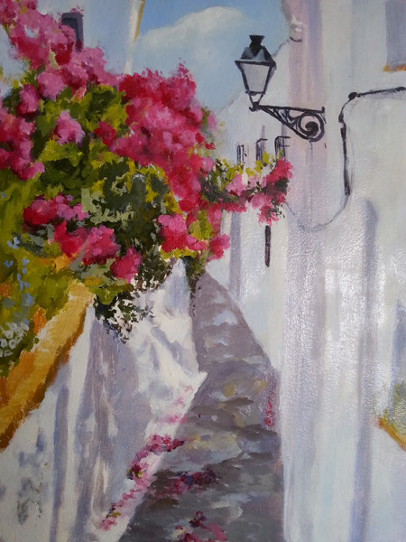 Oil Painting of a street in Andalucia . There are white walls and bougainvillea