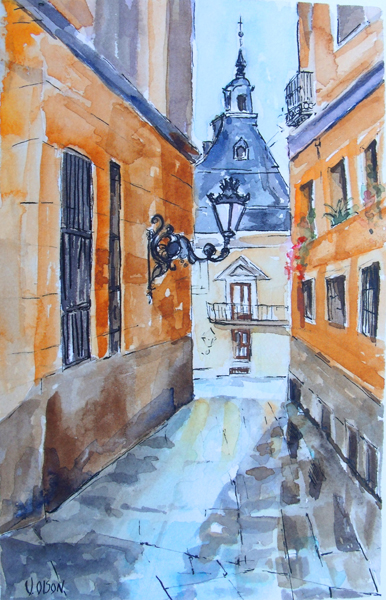 Watercolor of street in Madrid from the Golden Age. A narrow street with sighns of wetness from the rain on the stone cut ground. There is a lamp post attached to the left wall which is an orangish color.