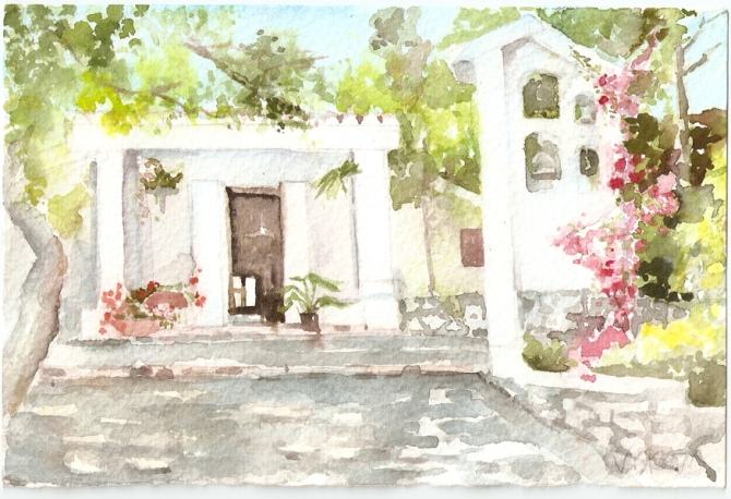 Ermita White building with bougainvillea creeping up the side of the bell tower.