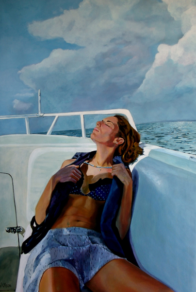 A woman on a boat relaxing after a swim.