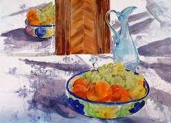 Watercolor of Fruit bowl full of fruit and blue glass ewer reflected in a mirror