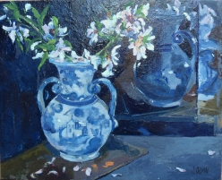 This is a small oil painting of Talavera vase with almond blossoms